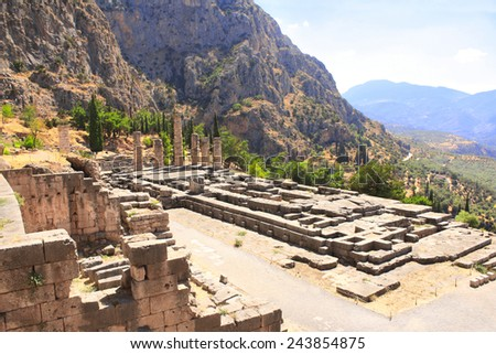 Ancient column and ruins of Temple of Apollo in the archaeological site of Delphi, Greece - stock photo