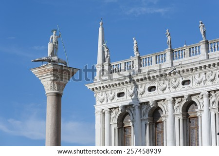 Ancient column in front of Palazzo Ducale (Doge's Palace) near San Marco Basilica. Venice, Italy. Venice - UNESCO world heritage. - stock photo