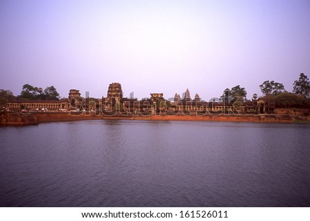 Ancient columned buildings from across a calm lake. - stock photo