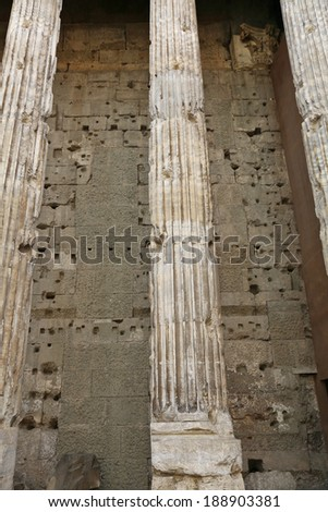 ancient columns against stone walls - stock photo