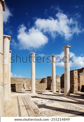 Ancient columns and floor mosaic in Delos, Greece. - stock photo