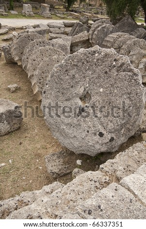 Ancient columns in Greece, on the floor, in mythical olympus, home of the greek pagan gods, Mount Olympus - stock photo