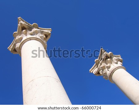 ancient columns of Greek temple on the background of sky - stock photo