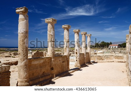 Ancient columns of temple ruins in archaeological park Tombs of the Kings, Paphos,Cyprus,UNESCO heritage site  - stock photo