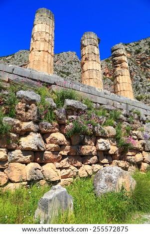 Ancient columns of the temple of the sun god Apollo, Delphi, Greece - stock photo