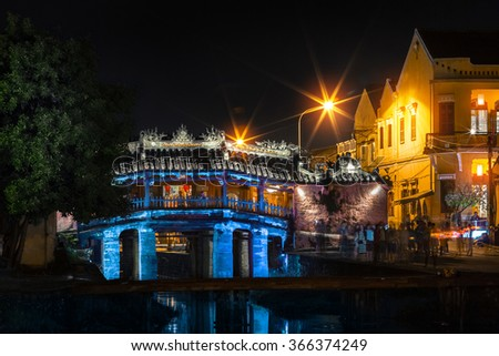 Ancient covered bridge in the city of Hoi An at night, Vietnam - stock photo