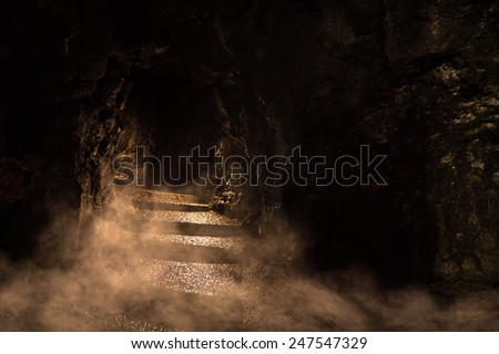 Ancient dark dungeon in the fog - stock photo