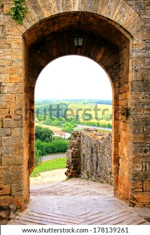 Ancient defensive gate of a village in Tuscany, Italy - stock photo