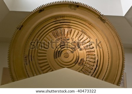 Ancient disk used for decoration of the pediment of Heras temple at Olympia, Greece