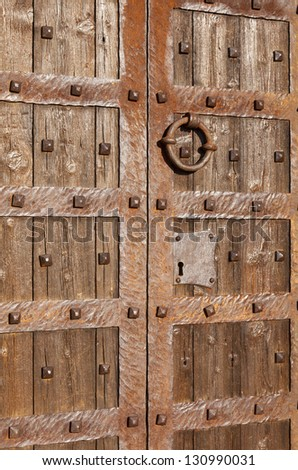 Ancient door adorned with nails of iron