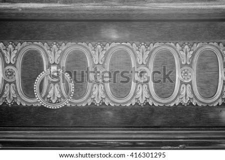 Ancient door handle on vintage wooden cabinet - stock photo