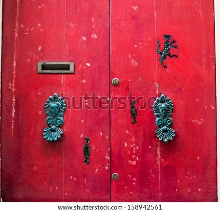 ancient door in a house on malta island - stock photo