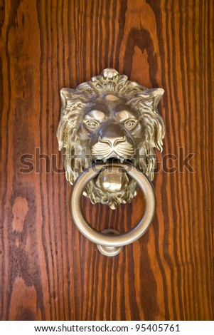 Ancient door knocker - stock photo