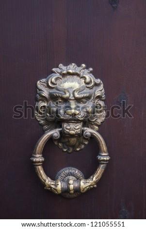 Ancient door knocker. Castle in Dubno. Ukraine - stock photo