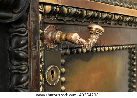 Ancient  door reliable protection close to - stock photo