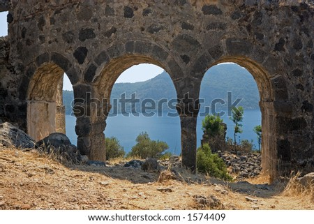 Ancient early Christian church ruins with the Mediterranean behind at St. Nicholas Island, near Fethiye, Turkey - stock photo
