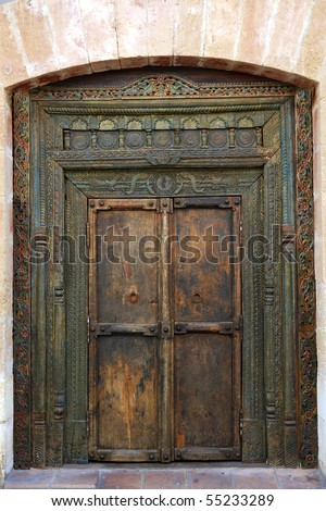 ancient eastern indian polychrome wooden entrance door - stock photo