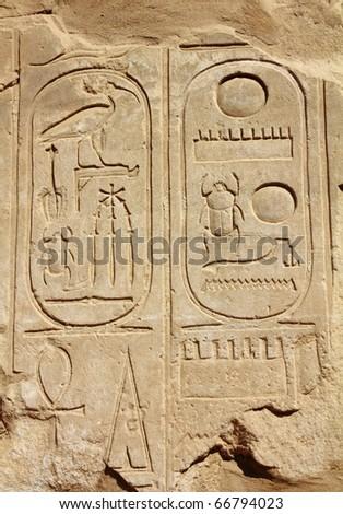 ancient egypt hieroglyphics on wall in karnak temple - stock photo