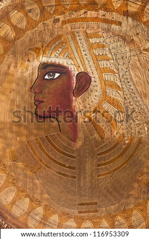 Ancient egypt style carved art work brass plate. - stock photo