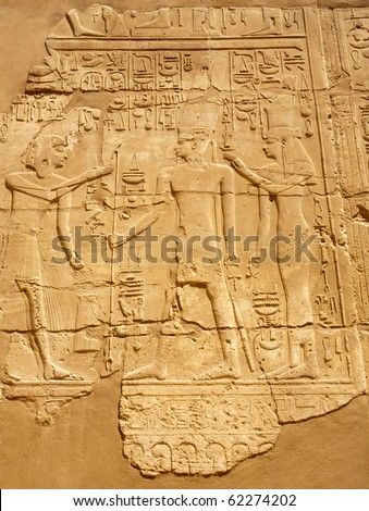 ancient Egyptian bas-reliefs on the wall of Karnak Temple, Egypt, Luxor - stock photo