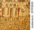 Ancient Egyptian gods and hieroglyphics painted on stone - stock photo