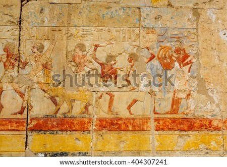 Ancient Egyptian painting of ancient Egyptian people in the battle on the engraved stone wall