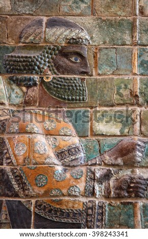 Ancient embossed colorful Achaemenid warrior from Susa of Iran. - stock photo