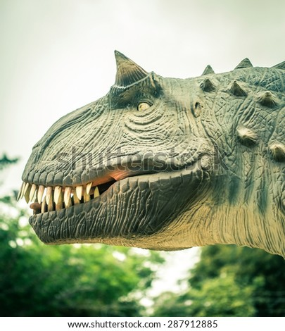 ancient extinct dinosaur on a background of plants - stock photo