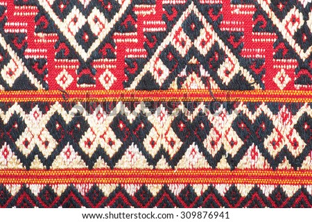Ancient fabric colorful thai silk handcraft peruvian style rug surface close up  motif  textiles peruvian stripe beautiful background tapestry persian detail pattern farabic fashionable vignette - stock photo