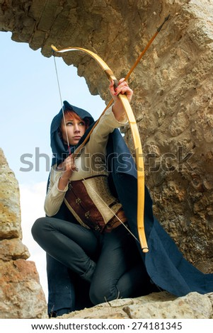 Ancient female archer with bow and arrow - stock photo