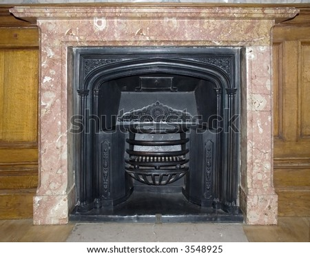 Ancient fireplace in room castle - stock photo