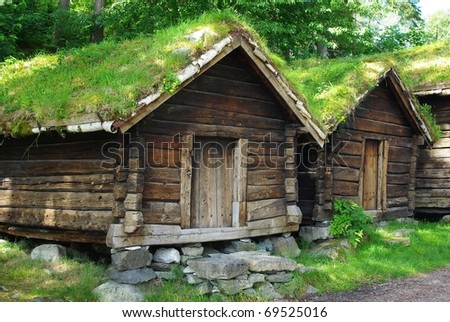 Ancient fisherman's  wooden huts  in ethnic park of Alesund, Norway - stock photo