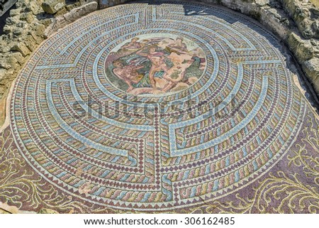 Ancient floor mosaic dating from the III to V century AD at Phaphos archaeological park, Cyprus. - stock photo