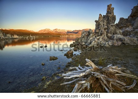 Ancient formations of tufa rocks at Mono Lake in California. The landscape looks like it is on the moon, and the environment is relatively harsh. - stock photo