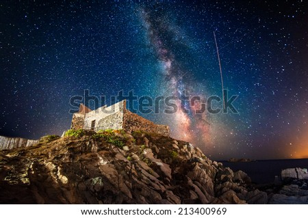 Ancient fortress at night under the milky way - stock photo