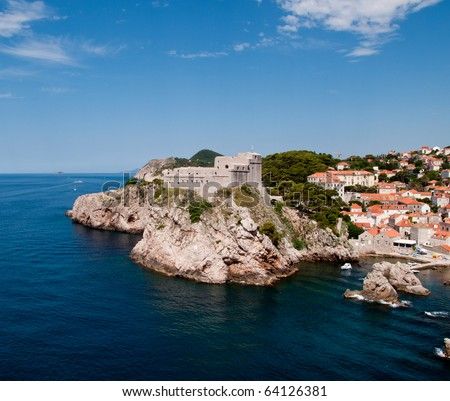 Ancient fortress on the cliff edge of Dubrovnik protects the port - stock photo