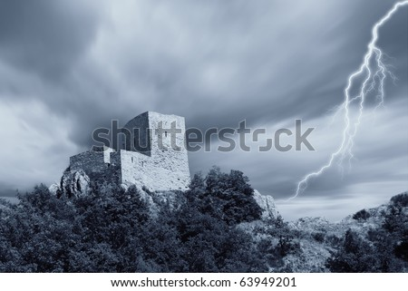 ancient fortress under the storm - stock photo