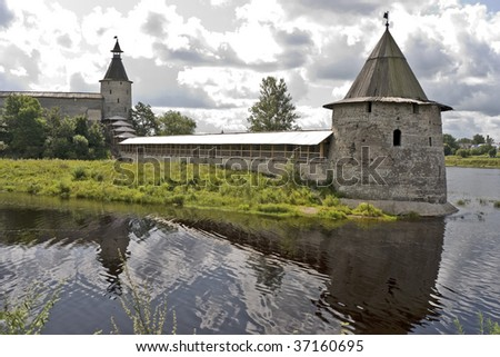 Ancient fortress walls and towers near river - stock photo