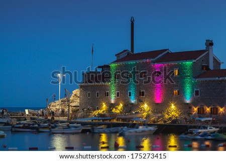 Ancient fortress with night illumination. Petrovac, Montenegro - stock photo