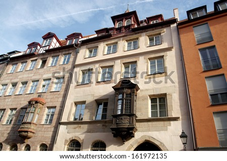 Ancient Franconian building with wooden alcoven in Nuremberg - stock photo