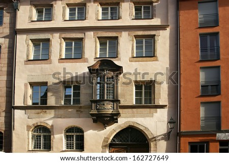 Ancient Franconian building with wooden projecting alcove in Nuremberg - stock photo
