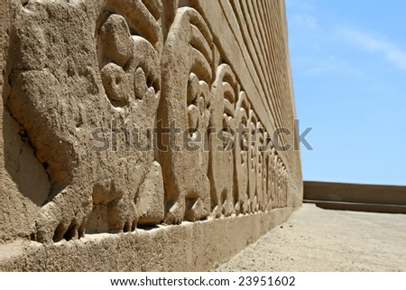 Ancient frieze carvings at the site of Chan Chan in Peru - stock photo