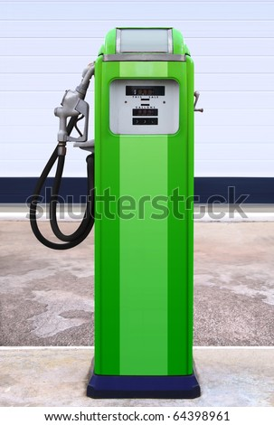 Ancient gas pump in the setting of an old gas station - stock photo