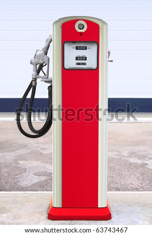 Ancient gas pump painted in bright dark blue and orange in the setting of an old gas station - stock photo