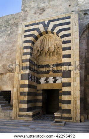 Ancient gate of the Old Citadel of Aleppo - stock photo