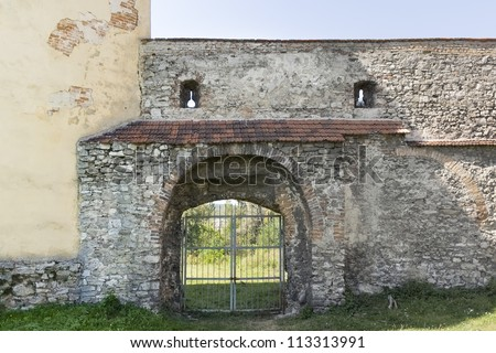 """Ancient gate of the Zhovkva Castle. Zhovkva - center of Zhovkivskyi district in Lviv region, Western Ukraine. Zhovkva was planned as an """"ideal city"""" of Renaissance. - stock photo"""