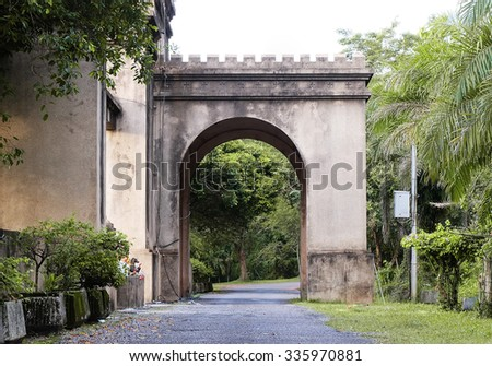 Ancient gate on the road in garden park, Thailand.