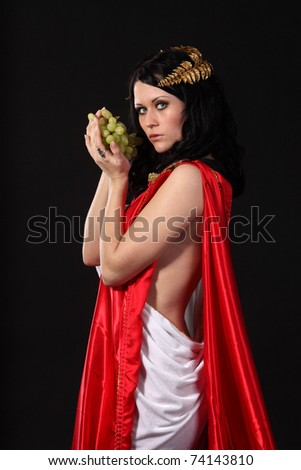 Ancient godness with a bunch of grapes - stock photo