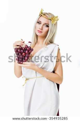 Ancient godness with a bunch of grapes. Isolated on white - stock photo