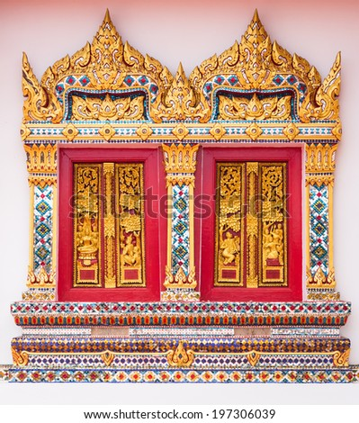 Ancient Gold carving wooden window of Thai temple - stock photo